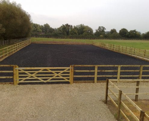 Completed outdoor horse arena in Gloucestershire with high quality rubber topping.