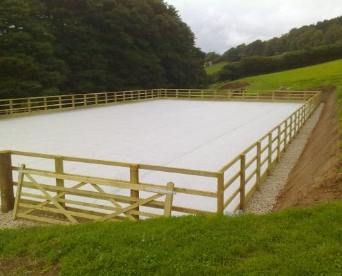 Outdoor arena (horse menage) cut into sloping field in Gloucestershire.